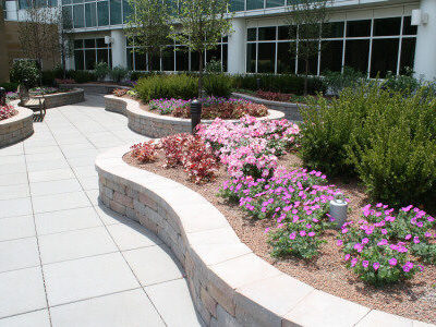 Both indoor and outdoor gardens feature curvilinear and artistic retaining walls, beautiful plantings and inviting sitting areas. In total, they contain over 1,200 linear feet of wall stone and caps.